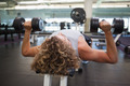 Young muscular man exercising with dumbbells in the gym - PhotoDune Item for Sale