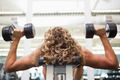 Close up of a man exercising with dumbbells in the gym - PhotoDune Item for Sale