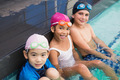 Cute swimming class in the pool at the leisure center - PhotoDune Item for Sale