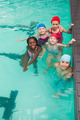 Cute little kids in the swimming pool at the leisure center - PhotoDune Item for Sale