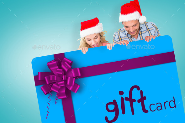 Young festive couple against blue vignette - Stock Photo - Images