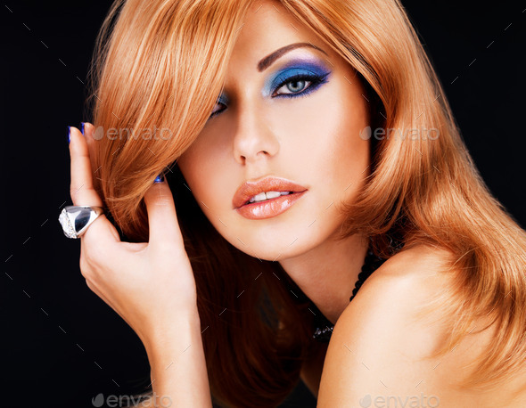 portrait of a  woman with long red hairs and  fashion makeup - Stock Photo - Images
