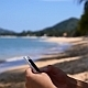 Typing on Smartphone on the Beach - VideoHive Item for Sale