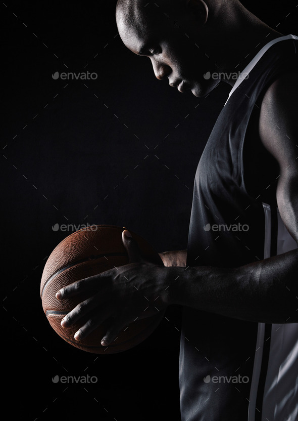 African sportsman holding basketball - Stock Photo - Images