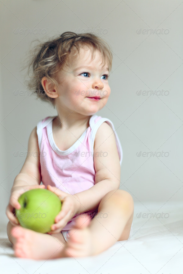 Baby and apple - Stock Photo - Images