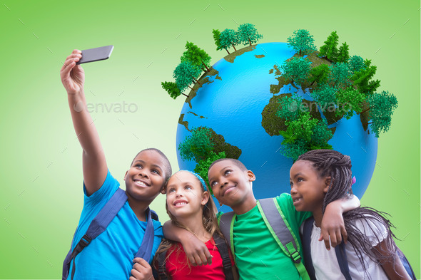 Cute pupils taking a selfie against green vignette with globe - Stock Photo - Images