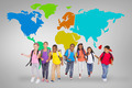 Elementary pupils running against grey vignette with world map