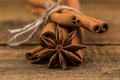 Close up of cinnamon sticks and star anise on wood - PhotoDune Item for Sale