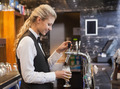 Barmaid pulling a glass of beer in a bar - PhotoDune Item for Sale