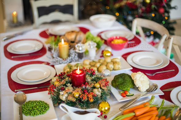 Table set for christmas dinner at home in the living room - Stock Photo - Images