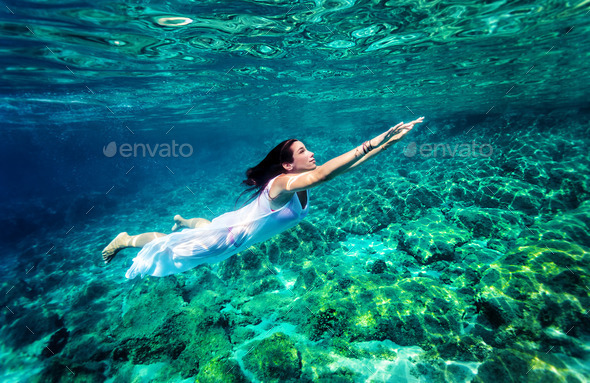 Refreshing swimming underwater - Stock Photo - Images