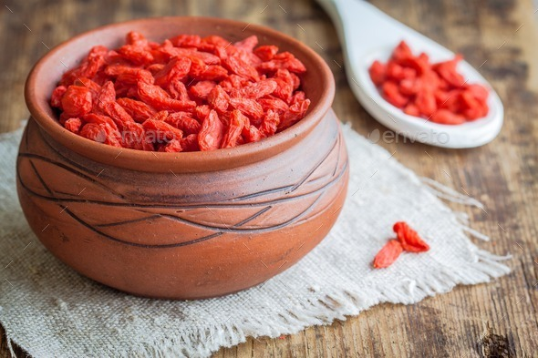 goji berries in a clay bowl - Stock Photo - Images