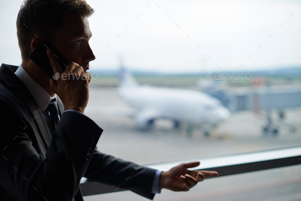 Calling in airport - Stock Photo - Images