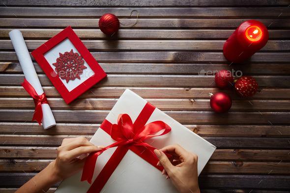 Preparing Christmas gift - Stock Photo - Images