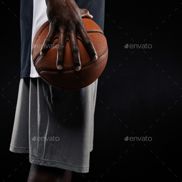 African basketball player holding ball - Stock Photo - Images