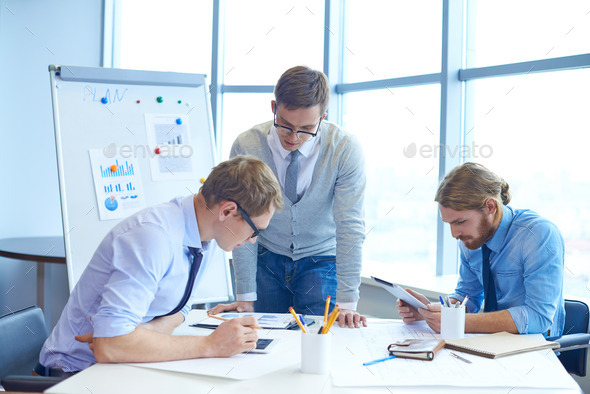 Businessmen at work - Stock Photo - Images