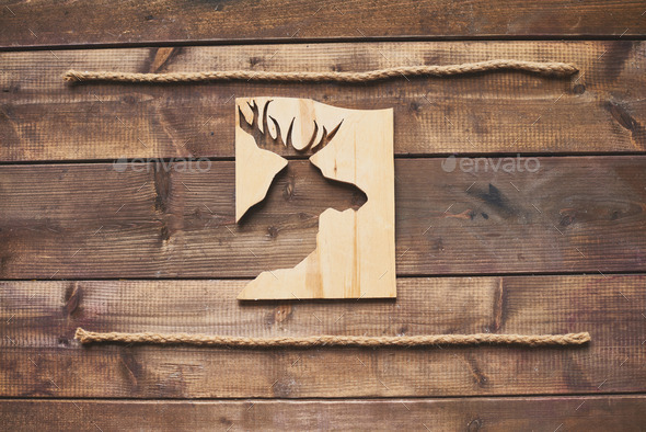 Deer cut in wooden board - Stock Photo - Images