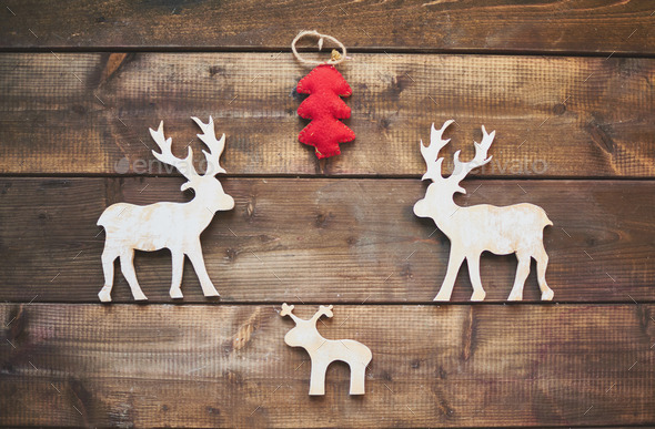 Wooden deer and red firtree - Stock Photo - Images