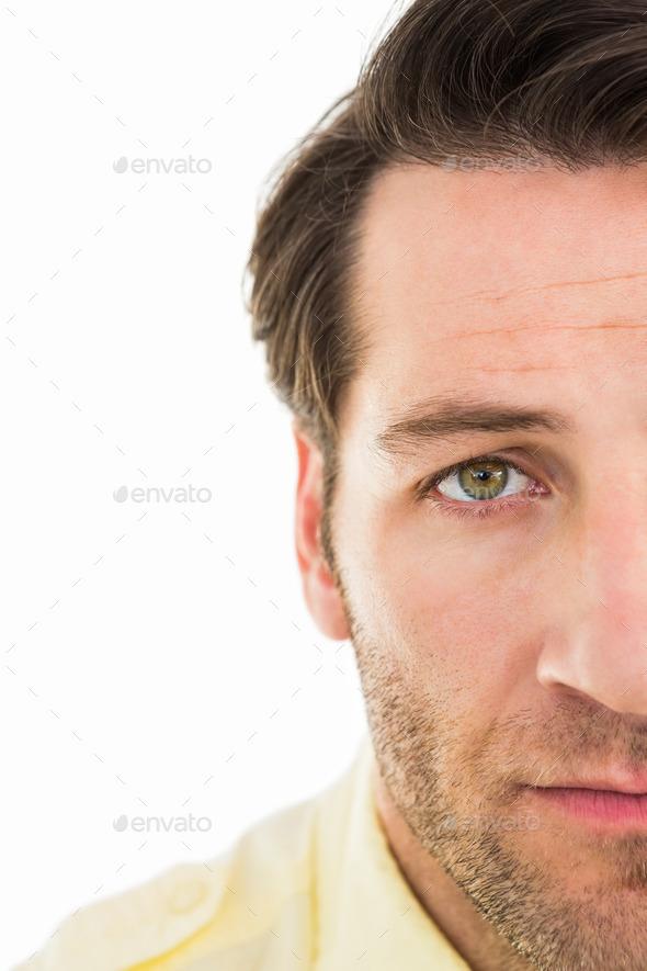 Close up of unsmiling man on white background - Stock Photo - Images