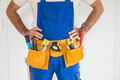 Handyman standing in tool belt in a new house - PhotoDune Item for Sale