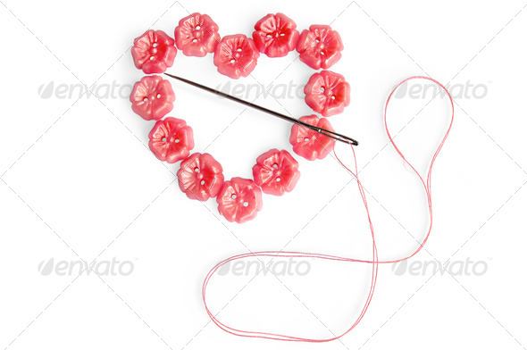 Heart of the buttons with needle - Stock Photo - Images