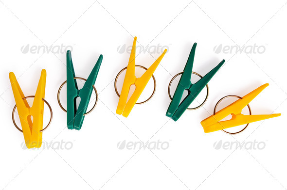 A number of yellow and green clothespins - Stock Photo - Images