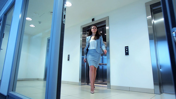 Young Woman Out of the Elevator in Office Building by motionteam ...
