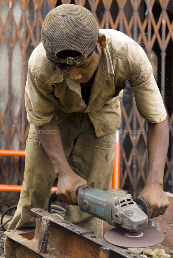 Asian Metal Worker - Stock Photo - Images