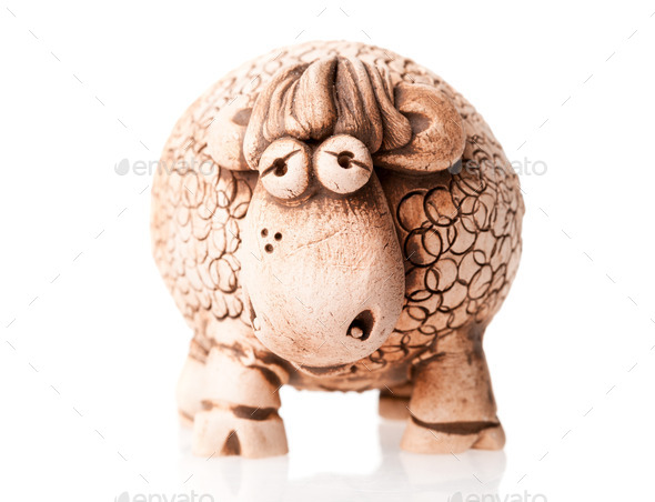 brown ceramic sheep statuette isolated on white background - Stock Photo - Images