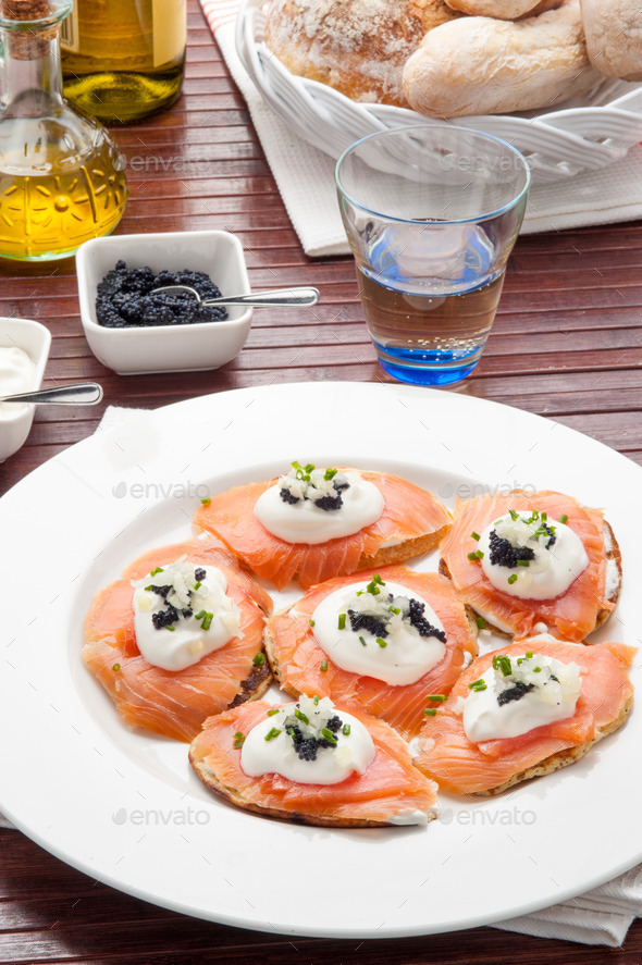 salmon canapes with traditional Russian caviar - Stock Photo - Images