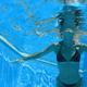 Woman Swimming In Blue Pool 1 - VideoHive Item for Sale
