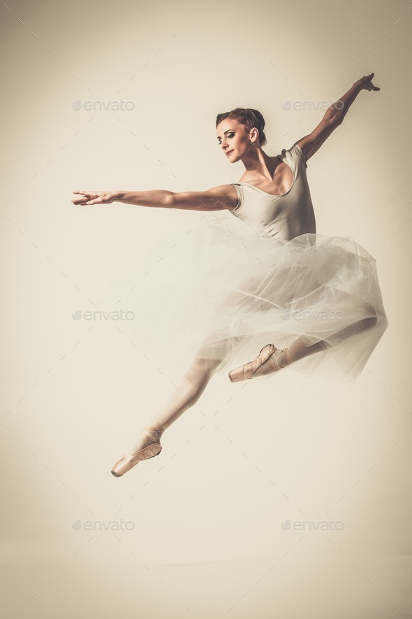 Young ballerina dancer in tutu showing her techniques - Stock Photo - Images