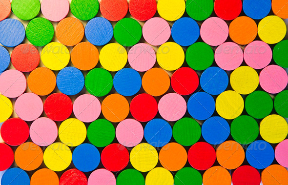 Colourful round wooden tokens - Stock Photo - Images