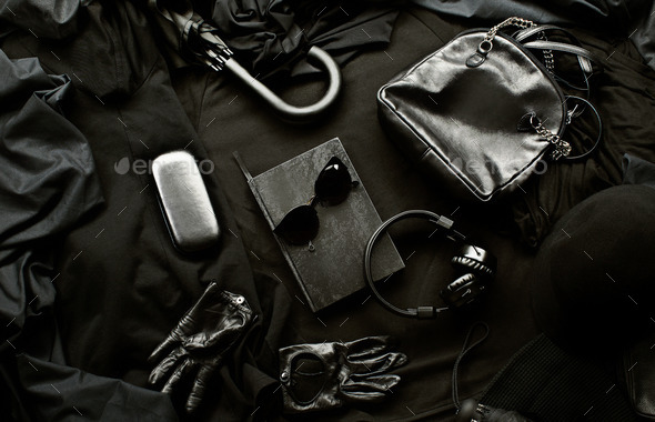 Set of trendy stylish black accessories and clothes on a black background - Stock Photo - Images