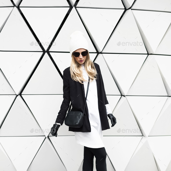 Glamorous blonde standing at the wall. Urban fashion black and w - Stock Photo - Images
