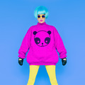 Fashion Lady loves panda. Funny photo. Girl in a bright wig on a