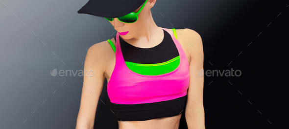 fitness lady in bright trendy sportswear on a black background - Stock Photo - Images