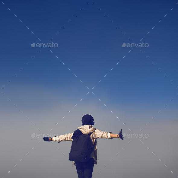 Lifestyle photo. girl tourist in thick fog greets morning hike. - Stock Photo - Images