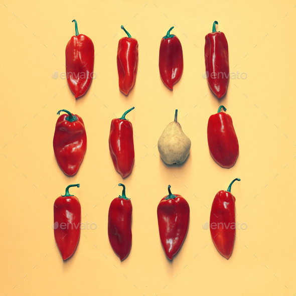 Set of neatly arranged bright peppers and one pear on a yellow background - Stock Photo - Images