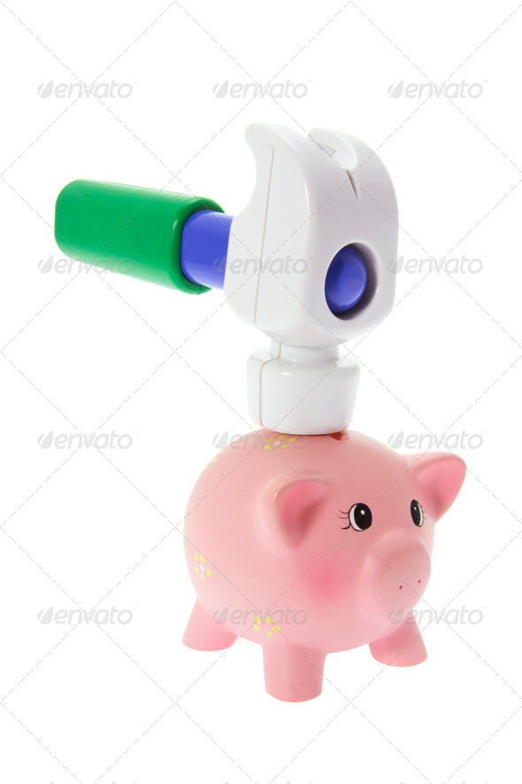 Miniature Piggy Bank and Toy Hammer - Stock Photo - Images