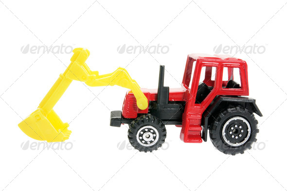 Miniature Plastic Earth Mover - Stock Photo - Images