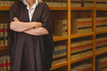 Lawyer leaning on shelf with arms crossed in library - PhotoDune Item for Sale