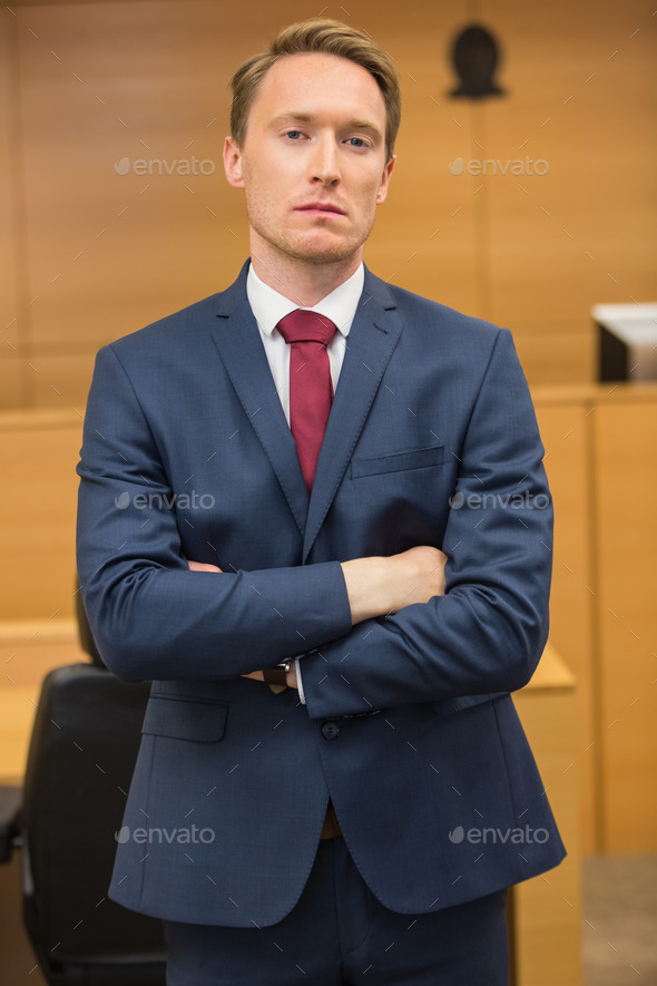 Serious lawyer looking at camera in the court room - Stock Photo - Images