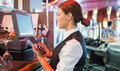 Focused barmaid using touchscreen till in a bar - PhotoDune Item for Sale