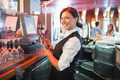 Pretty barmaid using touchscreen till  in a bar - PhotoDune Item for Sale
