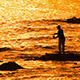 Fisherman With Spinning Silhouette At Sea Sunset - VideoHive Item for Sale