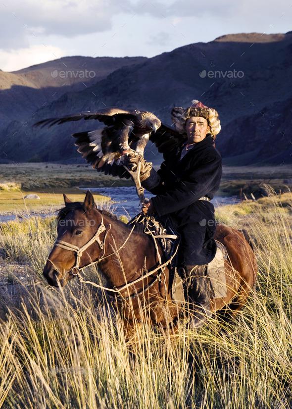 Kazakh on Horse With Eagle - Stock Photo - Images