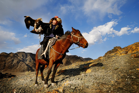 Mongolian Man with Trained Eagle - Stock Photo - Images
