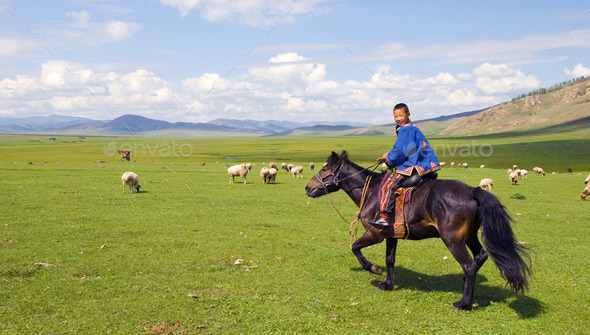 Boy Riding A Horse In A Beautiful Scenic View Of Nature - Stock Photo - Images