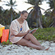 Woman After Shopping Using Tablet Pc On The Beach - VideoHive Item for Sale